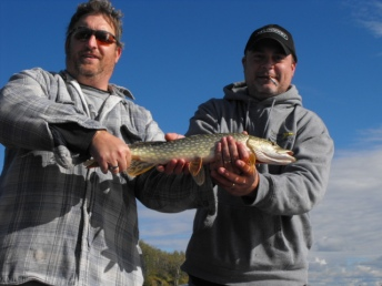 Chris (left) Brian (right) Northern Pike (center)